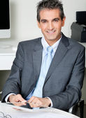Businessman With Digital Tablet Sitting At Desk — Stock Photo