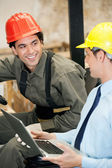 Supervisor and Forklift Driver With Laptop — Stock Photo
