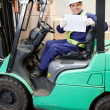 Forklift Driver Displaying Blank Placard — стоковое фото #14212225