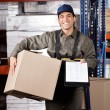 Supervisor With Clipboard And Cardboard Box — Stock Photo