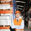 Male Supervisor With Arms Crossed At Warehouse — Stock Photo