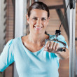 Happy Woman Working Out In Health Club — Stock Photo