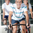 Stock Photo: On Exercise Bikes
