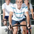 On Exercise Bikes — Stock Photo
