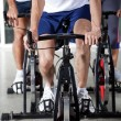 Stock Photo: Low Section Of On Exercise Bikes