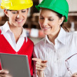 Female Supervisors Using Digital Tablet At Warehouse — Foto Stock