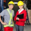Supervisor Holding Clipboard Standing With Foreman At Warehouse — Stock Photo #14218765