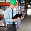 Supervisor Reading Book At Warehouse — Stock Photo #14218995