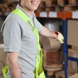 Foreman Holding Handtruck At Warehouse — Stock Photo