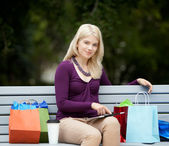 Woman on Park Bench with Digital Tablet — Stock Photo