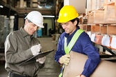 Foreman Looking At Supervisor Writing Notes — Stockfoto