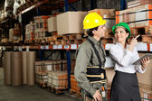 Supervisor With Foreman Pointing At Stock On Shelves — Stock Photo