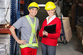 Supervisor Holding Clipboard Standing With Foreman At Warehouse — Stock Photo