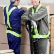 Stock Photo: ForemWith Colleague Working At Warehouse