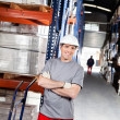 Warehouse Worker With Handtruck At Warehouse - Foto Stock