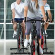 Friends On Exercise Bikes — Stock Photo