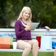 Woman with Digital Tablet in Park — Stock Photo