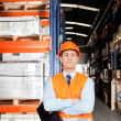Male Supervisor With Arms Crossed At Warehouse - Stock Photo