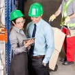 Stock Photo: Supervisors And ForemWorking At Warehouse