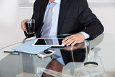 Businessman With Coffee Cup Using Digital Tablet — Stock Photo