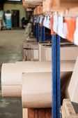 Cardboard Rolls And Boxes Stored In Warehouse — Stock Photo