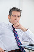 Businessman Relaxing In Office — Stock Photo