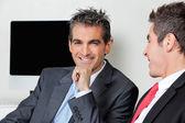 Empresario feliz con colega — Foto de Stock