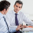 Businessmen Discussing Paperwork In Office — Stock Photo #14250169