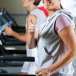Woman And Man Running On Treadmill — Stock Photo #14252579