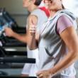 Woman And Man Running On Treadmill — Stock Photo