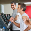 Stock Photo: Man Running On Treadmill In Fitness Club