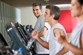 Man Running On Treadmill In Fitness Club — Stock Photo