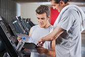 Instructor Guiding Man To Fill The Membership Form — Stock Photo