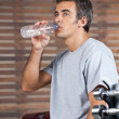 Man Drinking Water From Bottle At Health Club — Stock Photo
