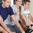Woman Showing Thumbs Up Sign While Exercising With Friends On Sp — Stock Photo #14263051