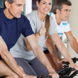 Stock Photo: Woman Showing Thumbs Up Sign While Exercising With Friends On Sp
