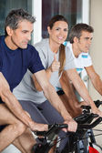 Woman Showing Thumbs Up Sign While Exercising With Friends On Sp — Stock Photo