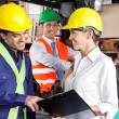 Supervisor Communicating With Foreman At Warehouse — Stock Photo