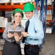 Supervisors Using Digital Tablet At Warehouse — 图库照片