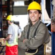 Young Foreman With Arms Crossed At Warehouse - Foto de Stock