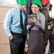Royalty-Free Stock Photo: Supervisors Using Digital Tablet At Warehouse