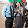 Supervisors Using Digital Tablet At Warehouse — Stock Photo #14478199