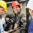 Stok fotoğraf: Workers And Supervisors At Warehouse