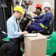 Foto Stock: Supervisor With Foremen Working At Warehouse