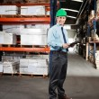 Confident Supervisor With Clipboard At Warehouse - ストック写真