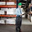 Confident Supervisor With Clipboard At Warehouse — Stock Photo