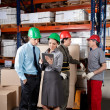 Supervisors And Foremen At Warehouse — Stockfoto