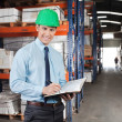 Confident Supervisor With Book At Warehouse — Stock Photo #14496065