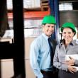 Supervisors With Digital Tablet At Warehouse - Stock Photo
