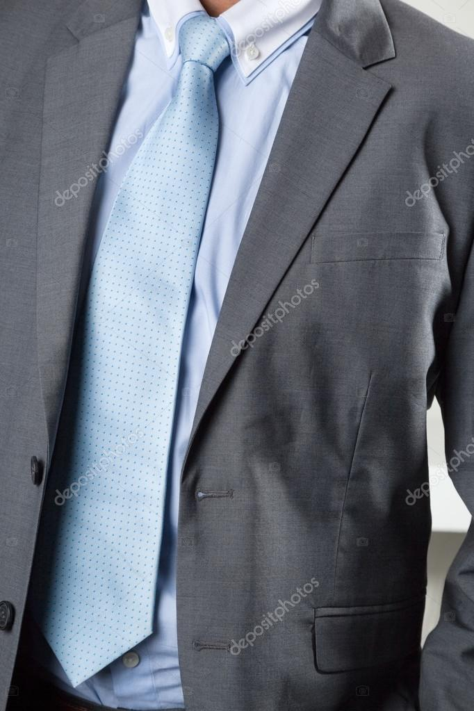 Midsection of businessman in suit — Stock Photo #14497683